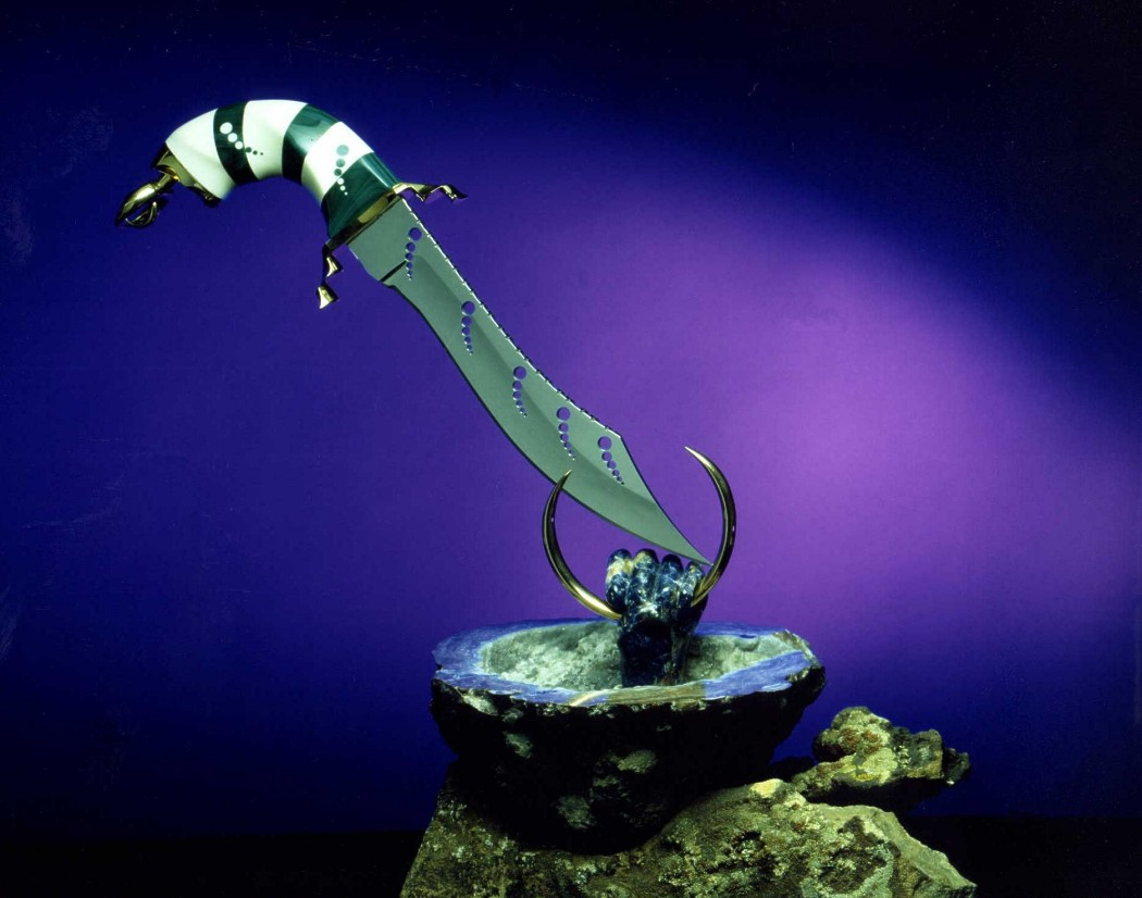 """Altar of Atlantis"" in milled ATS-34 high molybdenum stainless steel blade, brass guard and pommel, elephant ivory and malachite gemstone handle, stand of brass, sodalite gemstone, quartz geode, sandstone"