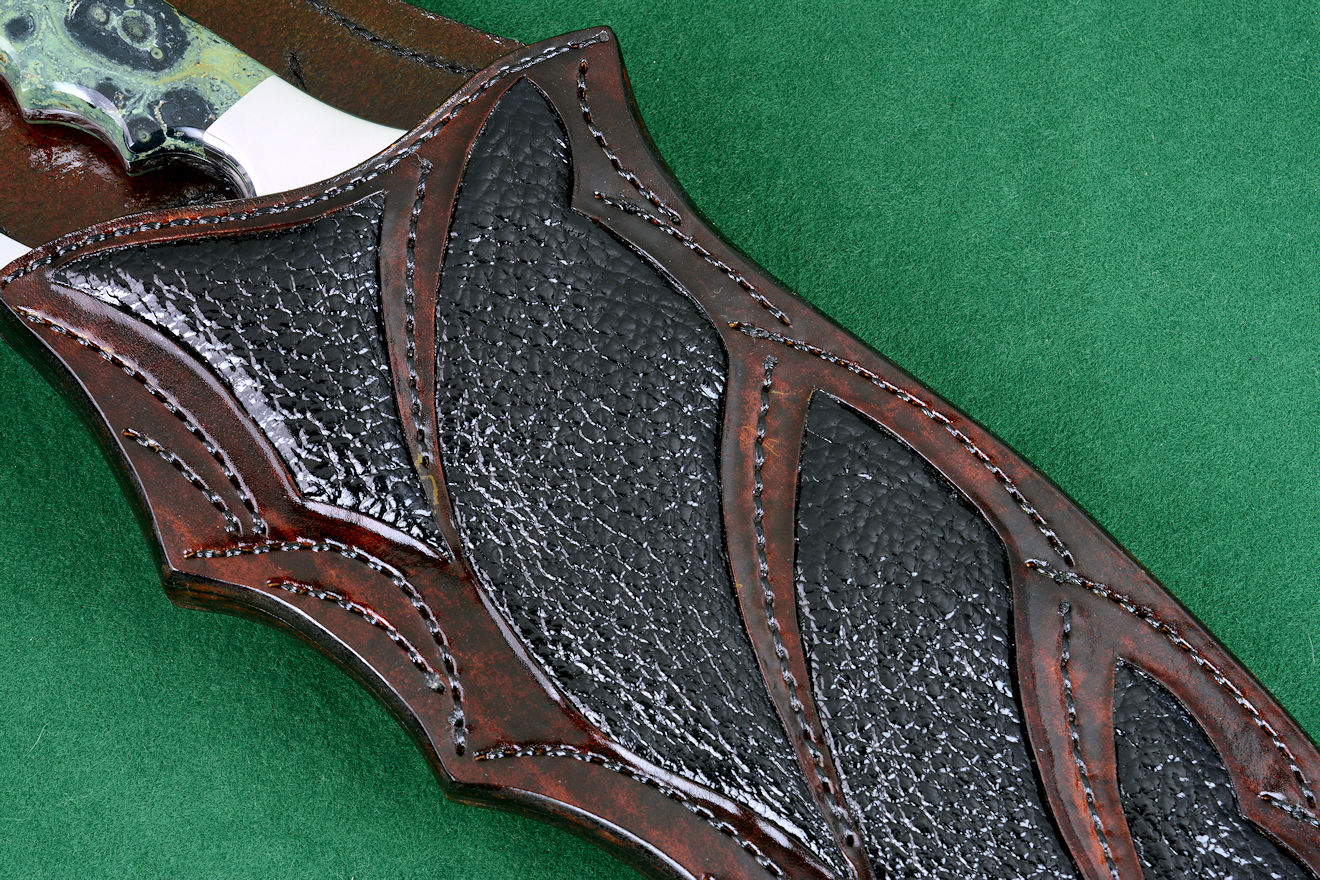 """Ananke"" knife sheath detail view of buffalo skin inlays in hand-carved leather with hand-stitching"