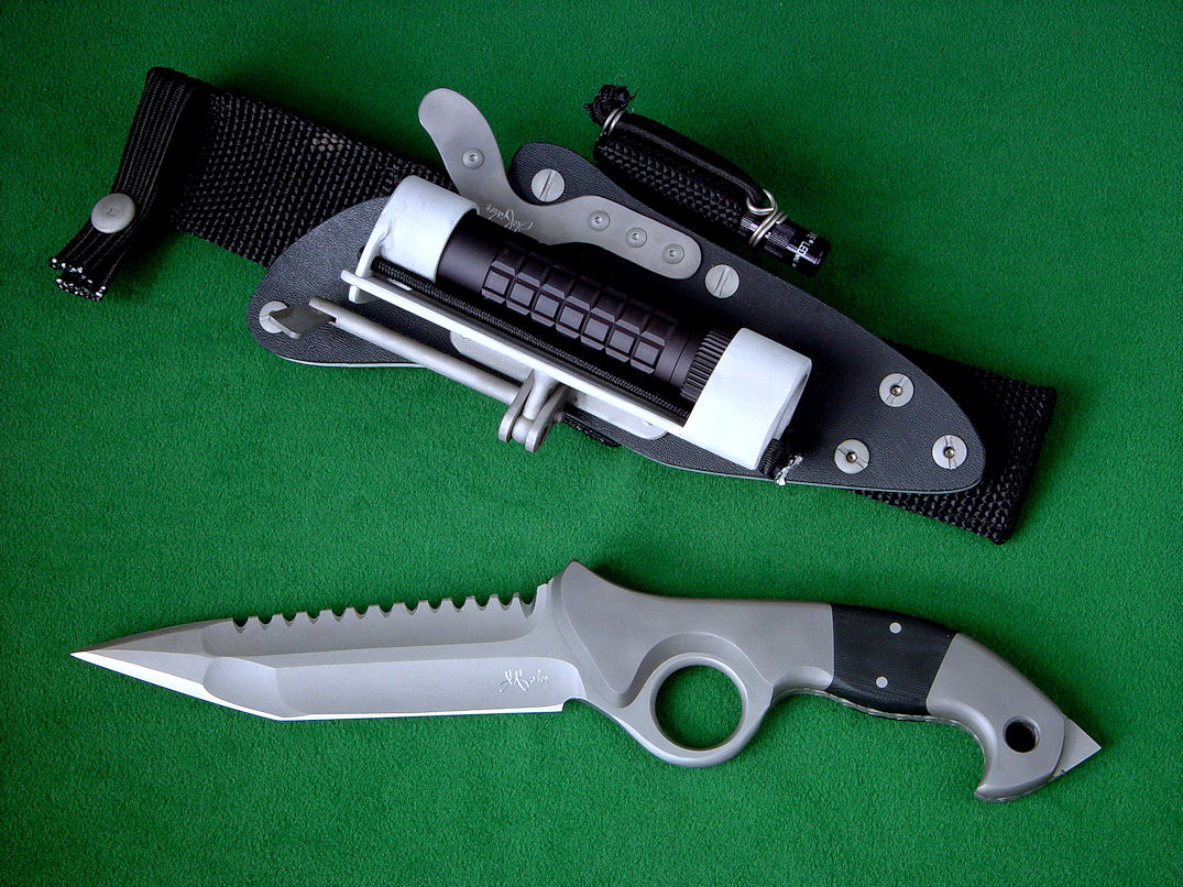 """Ari B'Lilah"" Tactical Combat Counterterrorism Knife, obverse side view in CPMS35VN high vanadium-niobium stainless steel blade, pure titanium bolsters, G10 composite handle, tension-locking sheath of kydex, aluminum, stainless steel, 6AL4V titanium, ultimate belt loop extender"