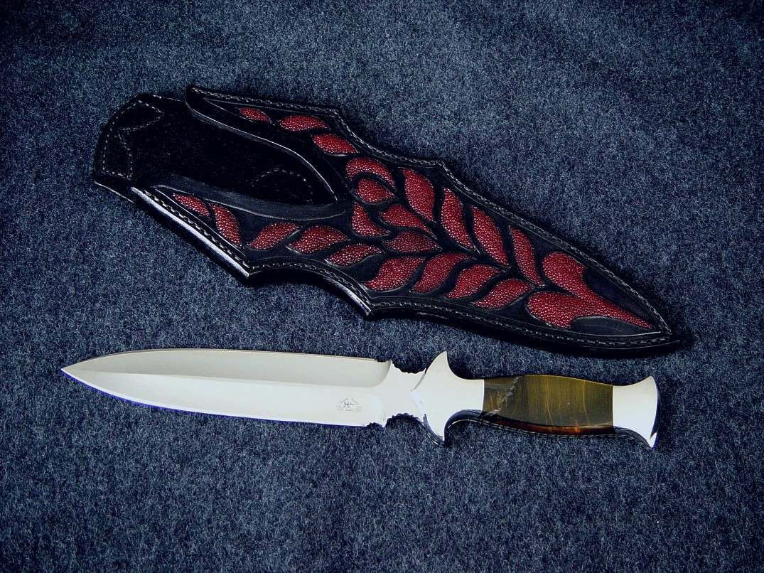 """Classic"" Dagger, obverse side view in 440C high chromium stainless steel blade, 304 stainless steel bolsters, Blue/Gold Tigereye gemstone handle, red Stingray skin inlaid in hand-carved leather sheath"