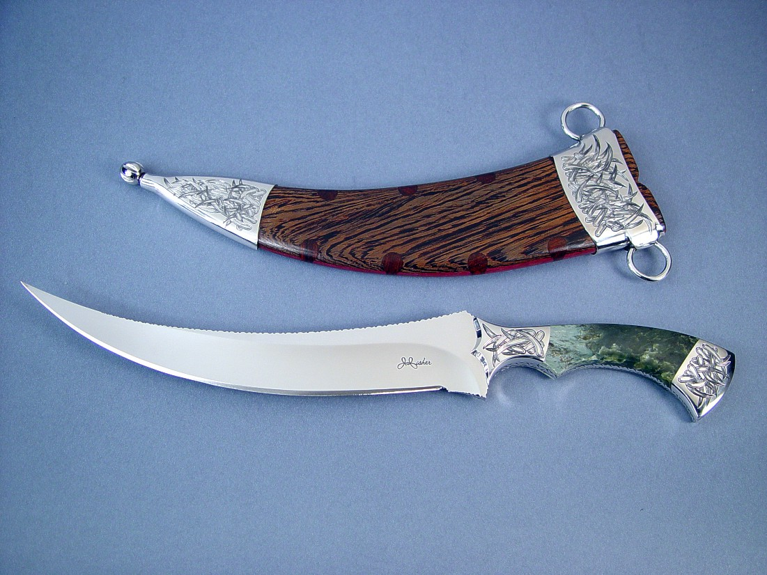 """Desert Wind""  Persian Dagger, Obverse side view: 440C high chromium stainless steel blade, hand-engraved 304 stainless steel bolsters, Mossy Nephrite Jade gemstone  handle, stainless steel engraved sheath, Wenge, Cocobolo, Purpleheart hardwood, with custom display stand"