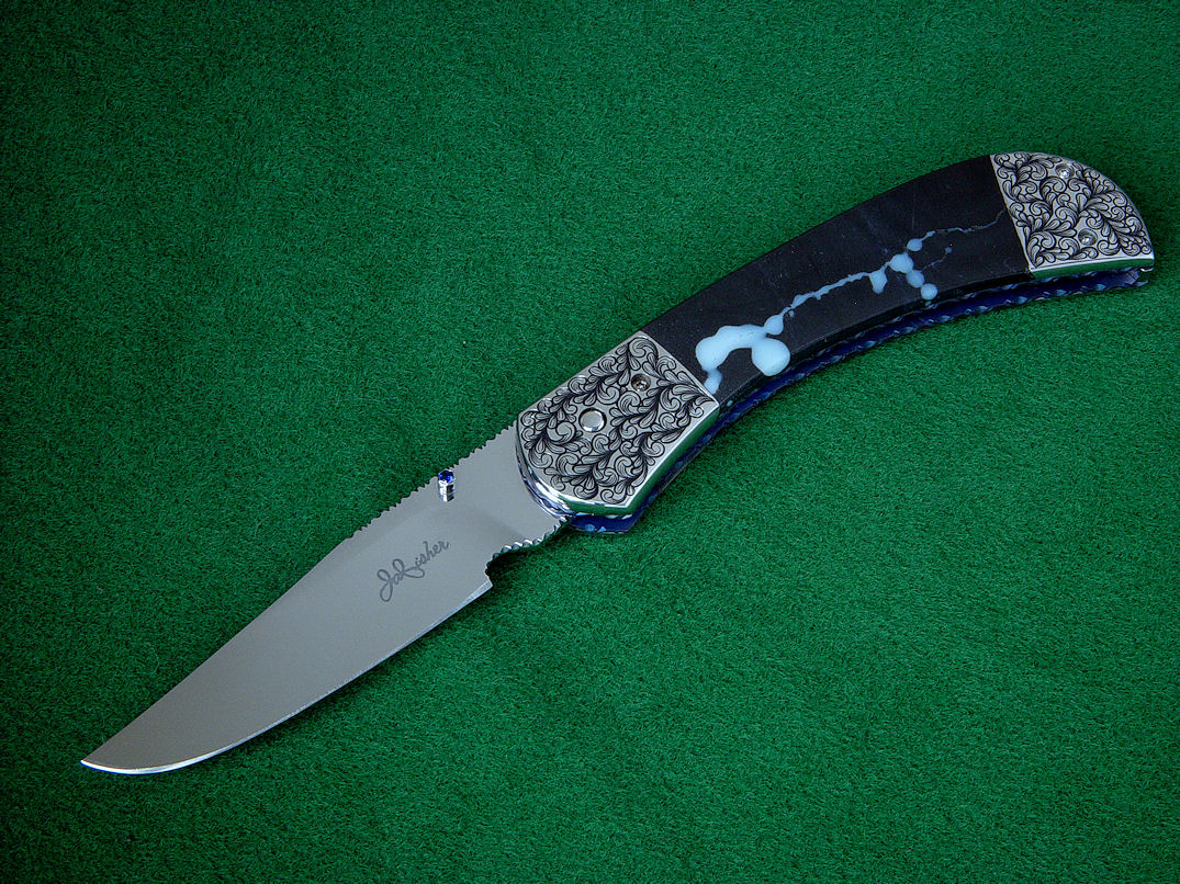 """Gemini"" liner lock folding knife, obverse side view. Hollow ground blade is mirror polished 440C stainless steel, thumbnail stud is 304 stainless steel set with 2mm faceted blue sapphires"