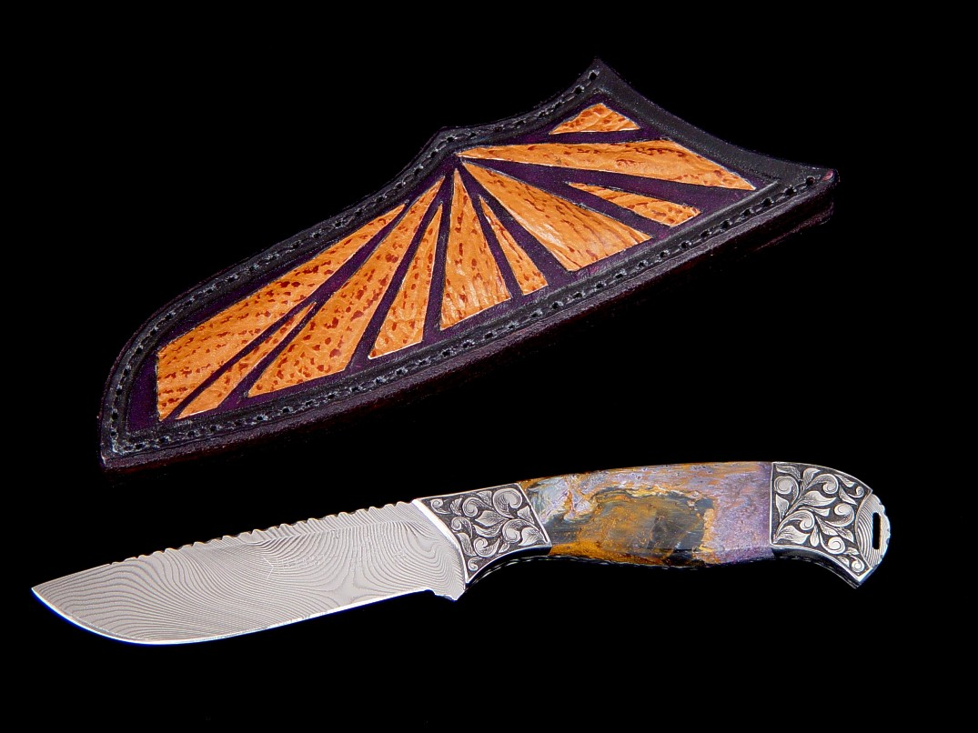"""Izar"" obverse side view in damascus stainless steel blade, hand-engraved low carbon steel bolsters, Peitersite gemstone handle, shark skin inlaid in leather sheath"