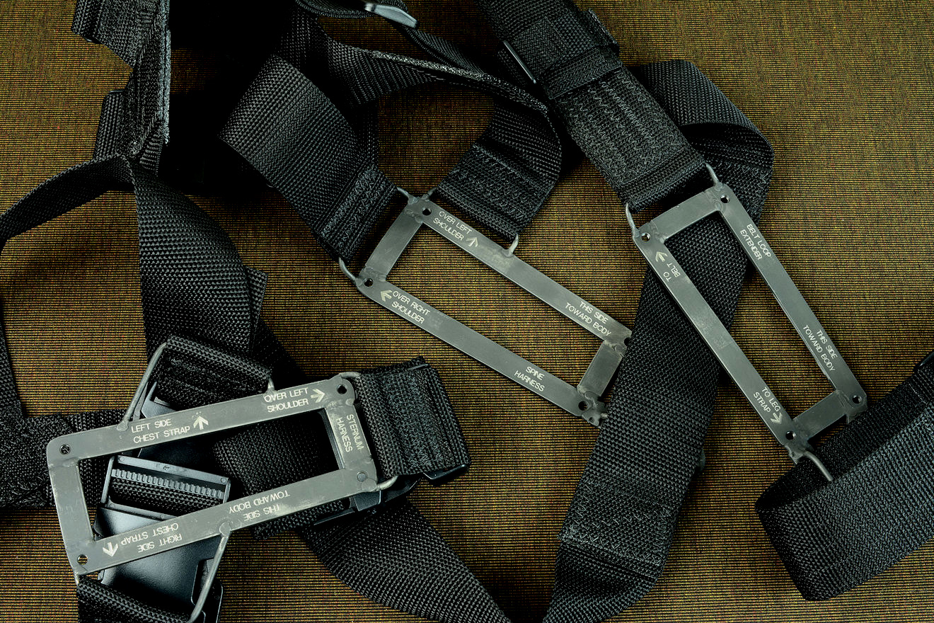 """PJ-CT"" black modular sheath wear options: Sternum harness, belt loop extender, and spine harness in black polyethylene, acetyl, and engraved blackened 304 stainless steel"
