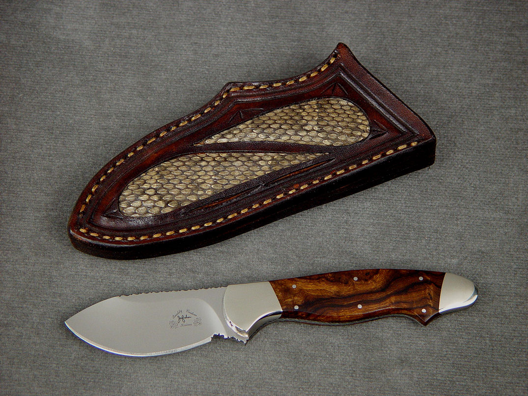 """Pluto"" obverse side view in 440C high chromium stainless steel blade, nickel silver bolsters, Desert Ironwood hardwood handle, hand-carved leather sheath inlaid with Prairie Rattlesnake skin"