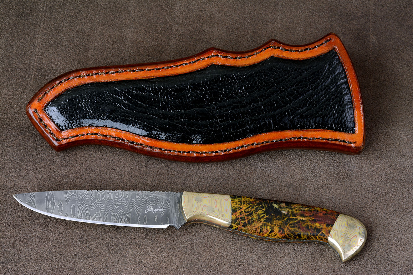 """Tarazed"" in stainless steel pattern welded damascus blade, mokume gane diffusion welded and forged bolsters, Pilbara Picasso Jasper gemstone handle, hand-carved leather sheath inlaid with ostrich leg skin"