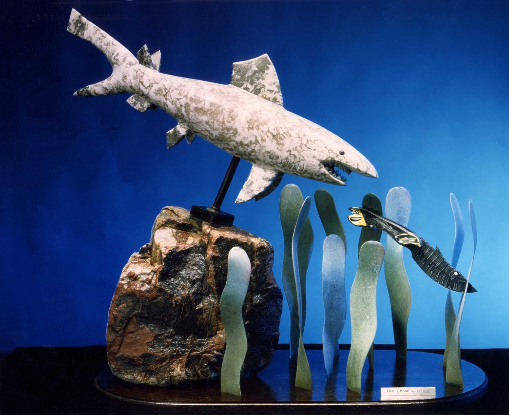 """The Chase"" knife sculpture in multiple media, carved and polished stone, metals, with engraving."