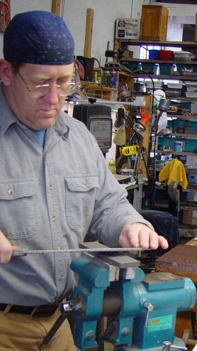 Sharpening the other blade side. Note the low angle of the blade on the stone