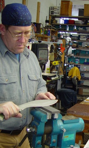 Here I am sharpeing a khukri blade on a hard ceramic stone