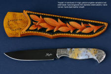 """Aquila"" obverse side view in mirror polished and hot blued O1 high carbon tungsten-vandium tool steel blade, hand-engraved 304 stainless steel bolsters, Golden Plume Agate gemstone handle, hand-carved, hand-dyed leather sheath"