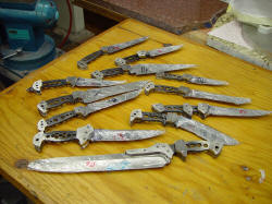 Multiple bolsters mounted on knives, peened solid.