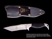 "New Mexico State Police Commemorative ""Last Chance"" with etched stainless steel blade, engraved black lacquered brass flashplate on sheath"