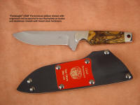 "Custom, commemorative USAF Pararescue ""Paraeagle"" in etched and mirror finished blade, engraved maroon lacquered brass sheath flashplate"