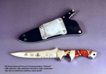 Etching in stainless steel is dark and highly detailed in this Special Forces commemorative knife