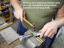 Driving zero clearance pins in bolsters and through knife tang