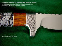 """Aspen"" Obverse side view:440c high chromium stainless tool steel blade, hand-engraved 304 stainless guard and pommel, Cocobolo hardwood and Snowflake Obsidian gemstone handle, hand stamped and tooled leather sheath"
