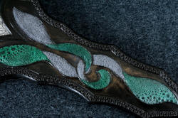 """Achelous"" sheath front inlay detail. Frog skin in green and gray matches gemstone and bolster steel colors and patterns"