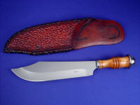 """Andrimne"" Chef's Master Knife, obverse side view in 440C high chromium stainless steel blade, 304 stainless steel guard ferrule and pommel ferrule, Peach hardwood turned handle, hand-stamped, hand-laced leather sheath"