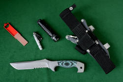 """Arctica"" Ultimate Belt Loop Extender accessories, left to right: Diamond pad sharpener, Maglite Solitaire LED, MagTac high intensity LED flashlight, Polypropylene extender mounted on locking sheath with LIMA and HULA flashlight holders."
