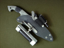 """Ari"" sheathed view. Sheath accessories can be located in many different position and orientations around sheath."