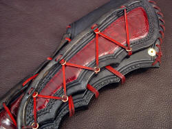 """Artemis"" sheath belt loop detail. Massive belt loop has individual tension bindings to match sheath front, and is zigzag stitched with black nylon"