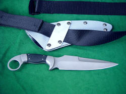 """Bulldog"" tactical combat knife, reverse side view. Note tension fit belt straps to rigidly secure knife sheath to utility belt"