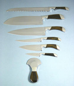 """Chef's Set"" knives view. From top to bottom: Bread knife, Vega Master knife, French Chef's Sabatier knife, Boning knife, La Cocina knife, Paring knife, Spice Chopper knife"