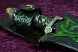 """Darach"" celtic dagger, sheathed view, retaining strap detail. Hand-carved, hand-dyed leather throughout"