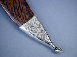 """Desert Wind"" reverse side chape tailpiece detail. Fine finial terminating the sheath in mirror polished stainless steel."