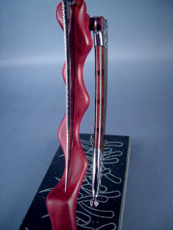 """Desert Wind"" stand detail.  Purpleheart hardwood in both stand and sheath welt matching."