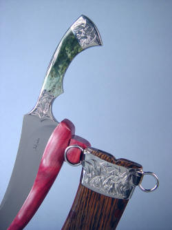 """Desert Wind"" stand detail. Sheath hangs on notched peg, knife cutting edge is secure in slotted Purpleheart"