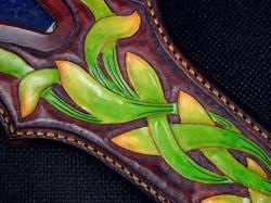 """Domovoi"" sheath front face detail. I used successive dying process to get the color transitions and contrast on the sheath tooled leather"
