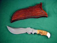 """Flamesteed"" tactical survival knife, obverse side view: 440C high chromium stainless steel blade, 304 stainless steel bolsters, Olive Burl hardwood handle, hand-tooled leather sheath"