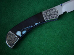 """Gemini"" linerlock folding knife, reverse side handle detail. This is a hard gemstone, very tough and will outlast all the metal components of the knife with little or no care."