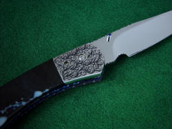 """Gemini"" folding knife, reverse side front bolster detail. Hand-engraving on 304 stainless steel is rare due to its very hard and tough character, but the material is zero care and extremely high longevity."