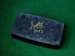 """Gemini"" granite case bottom, set with inlaid neoprene feet, with artist's signature."