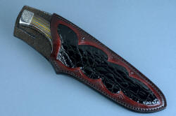 """Golden Eagle"" fine custom  handmade knife, sheathed view. Sheath is deep, with a high back for protection, fully inlaid with Caiman skin, finely stitched with polyester."