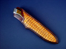 """Golden Eagle"" sheathed view. Sheath has natural caiman skin inlays in hand-carved leather shoulder"
