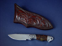 """Grus"" obverse side view in 440C high chromium stainless steel blade, hand-engraved 304 stainless steel bolsters, Spiderweb Jasper gemstone handle, hand-carved leather sheath"