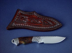 """Grus"" reverse side view. Sheath has tough hand-carved belt loop and border tooled sheath back"