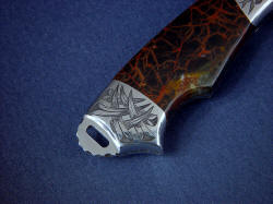 """Grus"" reverse side rear bolster engraving detail. engraved bolsters are contoured and finished, rear bolster allows access to milled lanyard slot in knife tang."