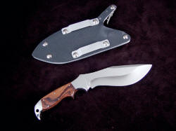 "Reverse view, Hooded Warrior. Note deep, clean hollow grind, 1.75"" aluminum belt loops in locking sheath"