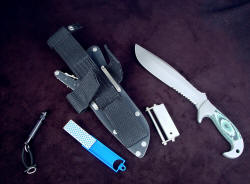 """Imamu"" sheath accessory view. Accessories include diamond pad sharpener, magnesium/firesteel fire starter, Maglite solitaire flashlight with all stainles steel fittings"
