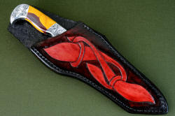 """Knapp Trailhead"" sheathed view. Sheath is deep yet displays bold handle, engraving is repeated in hand-carved, hand-dyed leather"