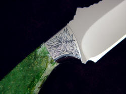 """Mercator"" reverse side front bolster engraving detail. Design is like seaweed fronds, interlocking and flowing, blending well with intense green jade gemstone"