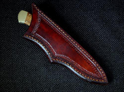 """Mirach"" sheathed view. Sheath is deep and protective, with simple execution and clean lines"
