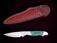"""Nihal"" obverse side view in CPMS60V high vanadium tool steel blade, 304 stainless steel bolsters, green, black canvas reinforced micarta handle, basketweave leather sheath"