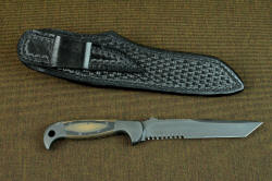 """PJLT"" reverse side view with sheath back. Sheath has high belt loop, accommodating a 1.5"" belt width"