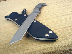 """PJ"" tactical defensive knife, blade point view. The tanto blade is thin, yet very strong due to the wide angle of the point."