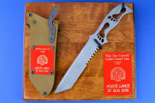 """PJSK"" Custom Commemorative/Tactical Combat knife, obverse side, plaque view in 440c high chromium stainless steel blade, hybrid tension-locking sheath in kydex, anodized aluminum, titanium, stainless steel with plaque of ash and engraved laquered brass"